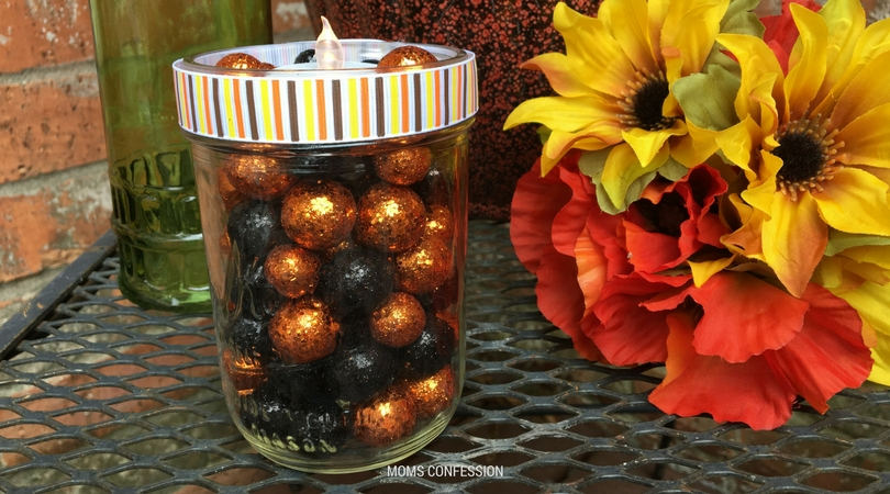 This diy mason jar craft votive candle is the best craft idea for fall. Make this craft in less than 10 minutes and have the perfect centerpiece for fall.