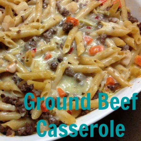 ground beef casserole in a dish with pasta and beef