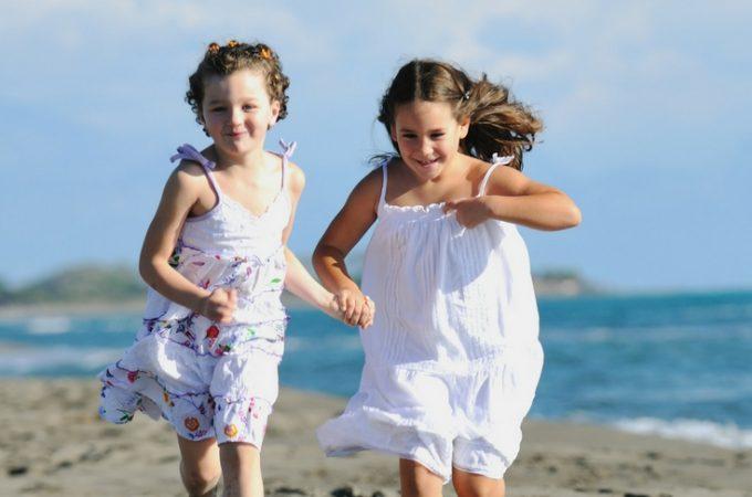 kids running on the beach in summer