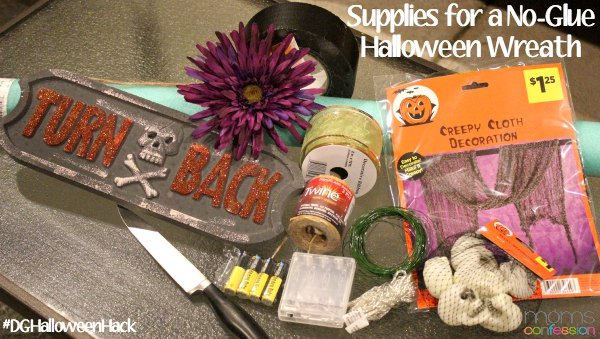 Everything you need to make a simple no-glue Halloween wreath can be found at Dollar General!