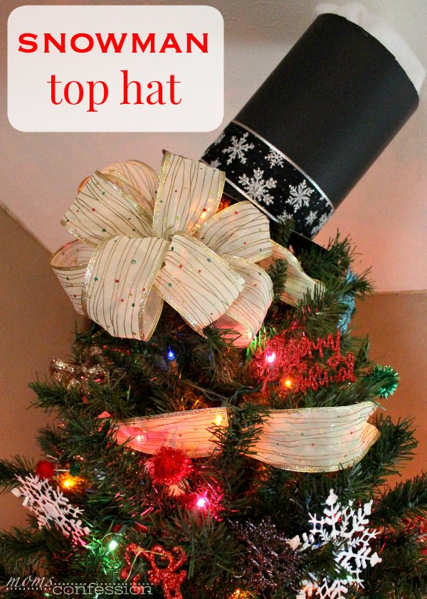This snowman tree topper for Christmas is the ultimate holiday decor for your tree. It's the game-changer you are looking for this holiday season!