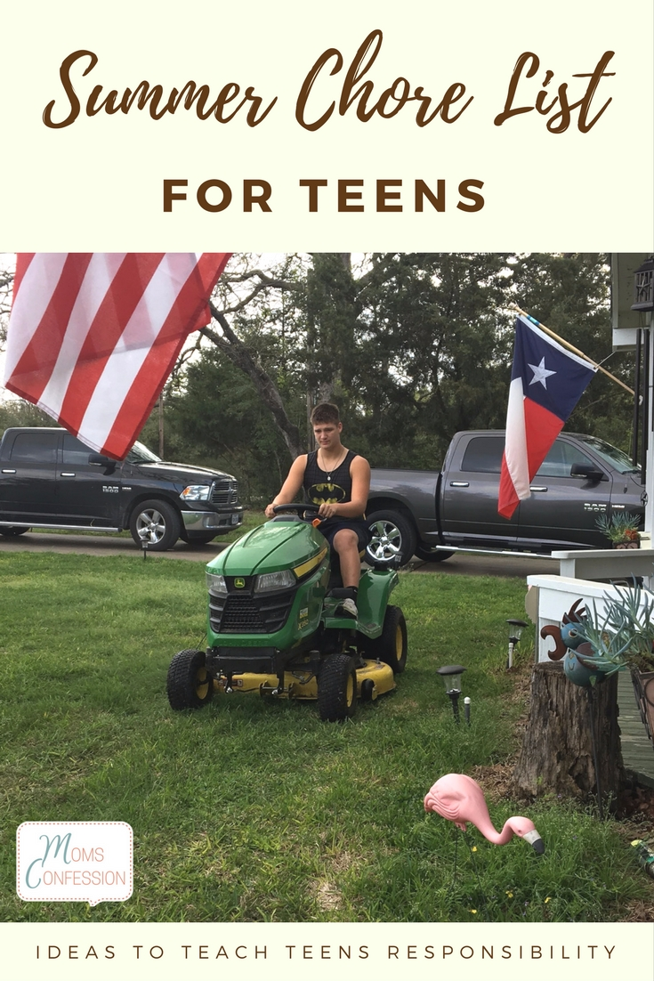 boy riding on a lawnmower
