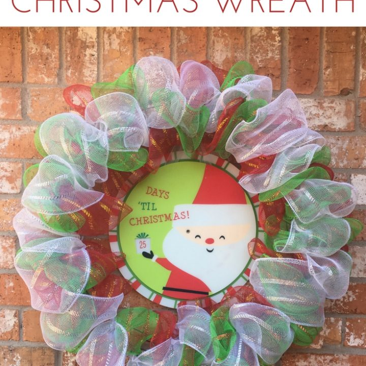 Make this DIY Advent Christmas Wreath to hang on your door this holiday season! A great DIY craft your kids will love seeing arrive for the season!
