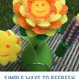 Scrub Daddy Dishwand System on a Table to Refresh your Home for Spring