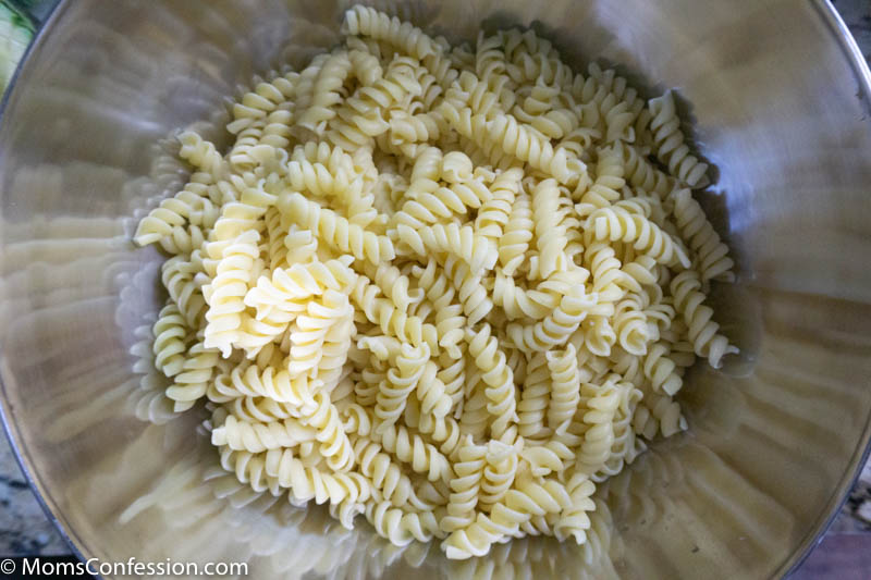 rotini noodles in a large mixing bowl