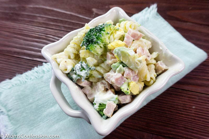 Angle photo of Leftover Ham Pasta Recipe in a white square bowl on a table ready to eat
