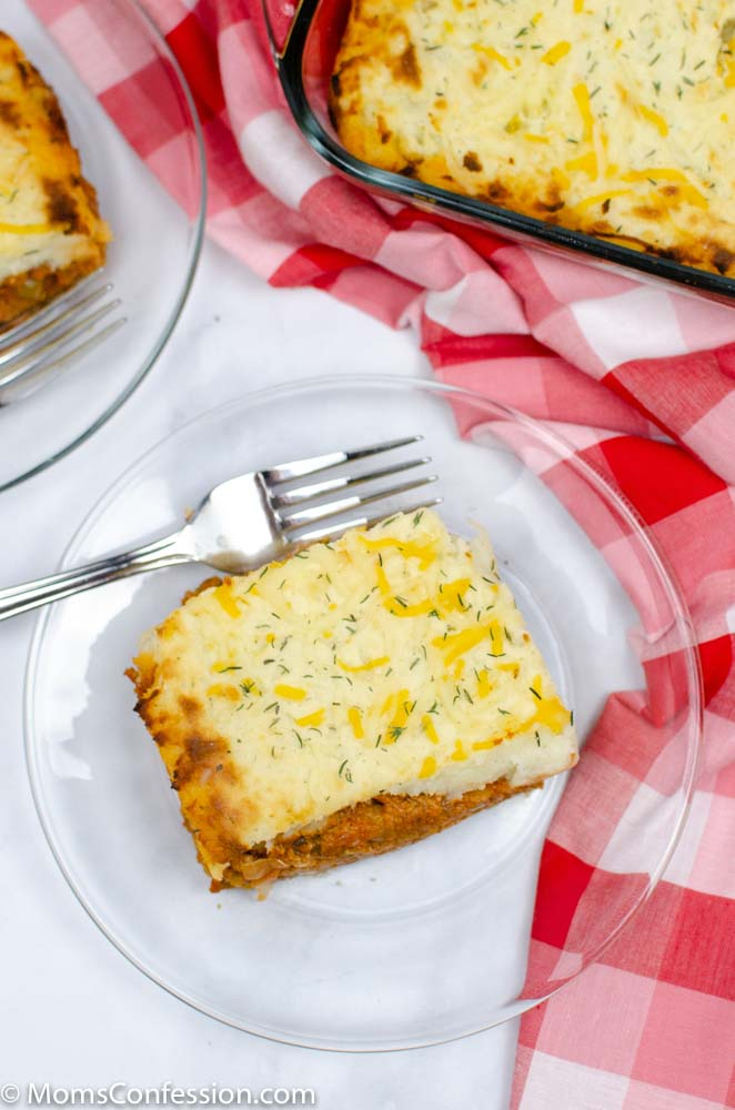 portrait overhead image of Easy shepherds pie recipe on a clear plate with a fork