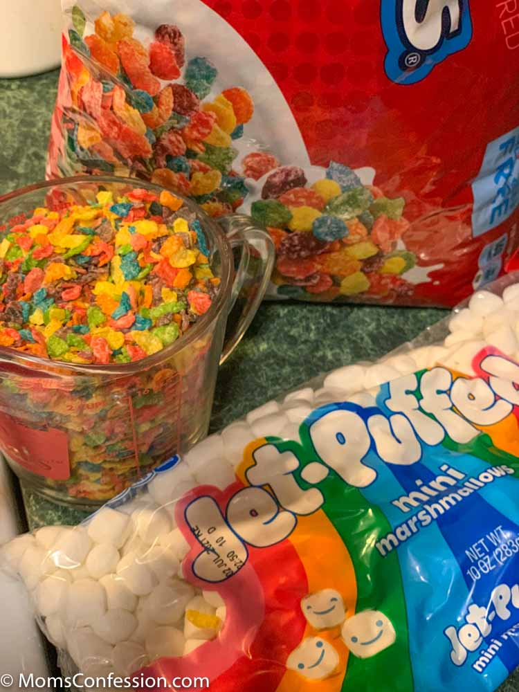 Fruity Pebble Rice Crispy Treats ingredients on a counter