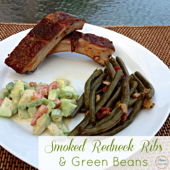 smoked ribs on a plate with cucumber salad and green beans